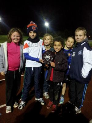 Presenting Sam his U11 Track Champion Shield